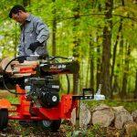 Man using gas powered log splitter